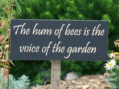 """The hum of bees is the voice of the garden"" sign."