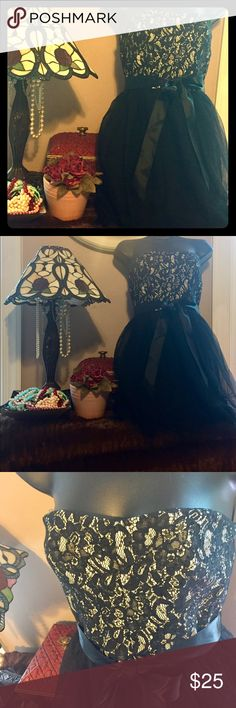 NWT Wet Seal Black Lace & Tulle Semi-Formal Dress NWT Women's or Junior's Size 5 Wet Seal Black Lace Dress. Crochet Black Lace over Cream Heart Shaped Bodice and Layered Tulle w/Black Ribbon Detail. Bran NEW & Perfect Condition! BUNDLE & SAVE! I Welcome All Offers. Wet Seal Dresses Mini