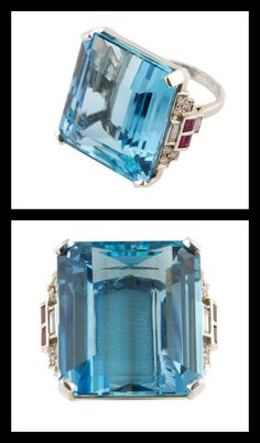 35.97 ct. Aquamarine Ring. A fine quality Aqua that has crisp blue intense saturation of color. Set in an 18k white gold superlatively crafted ring and accented by diamonds and rubies.
