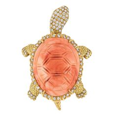 Gold, Carved Coral and Diamond Turtle Brooch   18 kt., the turtle's shell composed of one oval carved coral approximately 24.0 x 30.7 mm., edged by 36 round diamonds, accented by four diamond-set feet and tail applied with textured scales, centering a movable head, pave-set with 49 round diamonds, totaling 97 diamonds approximately 1.50 cts., approximately 17 dwt.