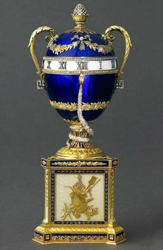 One of two eggs ordered by Emperor Nikolay II in 1895 as a present, this one - for his mother Maria Feodorovna. The egg is known as The Egg-Clock With A Blue Snake, was created in the traditions of Frit porcelain factory at Sèvres, France. The snake is stationary and performs as an hour hand. Today the egg is kept by Albert II, reigning monarch of the Principality of Monaco, and head of the Princely House of Grimaldi.