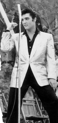 ELVIS because I adore him and really admire him and love his music he was one of a kind and Id like to meet a man who looks like him and go to GraceLand and vegas=)