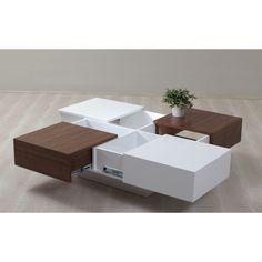 A modern storage solution, this white and walnut 4-drawer coffee table provides easily accessible but covert drawers. Made from high quality MDF, walnut veneers, and wood this coffee table is durable and stylish.