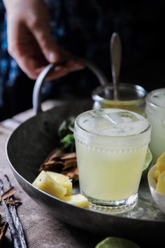 Spiced Pineapple and Cilantro Margaritas. Cinnamon and vanilla bean infused pineapple syrup, tequila, lime and delicious Solerno liqueur.