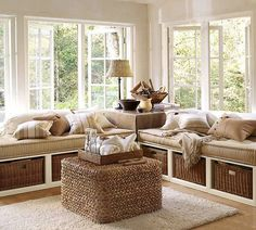Love a window seat with storage and lots of pillows.