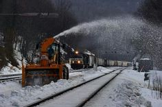 A Norfolk Southern train passes a MOW tractor clearing snow near Altoona, PA. Railroad Wife, Southern Trains, Norfolk Southern, Snow Plow, Train Tracks, Winter Fun, Locomotive, Tractors, Boat