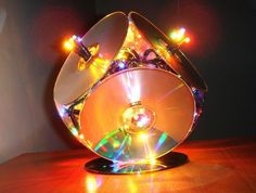 recycled CD lamp made with CDs and Christmas lights! Would be fun cheap way to make a disco type light for kids!
