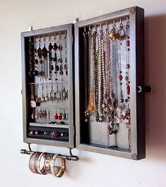 This is a jewelry organizer / cabinet designed and crafted by me. Functional with an artistic flare is my goal when making functional pieces. Something you can use every day and be well-pleased to display in your bedroom or elsewhere as a piece of art. Designed on GRAY STAIN color, is