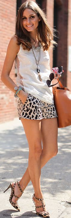 Olivia Palermo does it again. So chic! white sleeveless top with leopard shorts! perfect for summer!