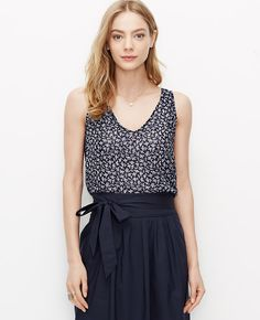 Strewn+in+fresh+summer+florals,+this+breezy-cool+style+is+hot+on+our+list.+V-neck.+Sleeveless.+Shirred+front+and+back+yokes.+Back+keyhole+with+button+closure.+Shirttail+hem.