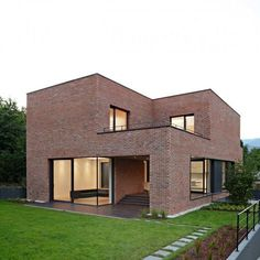 Brick house exterior its intriguing to see a modern house done completely in brick travel in . Modern Brick House, Brick House Designs, Modern Family House, Brick Design, Modern House Design, Brick Houses, Concrete Houses, Brick Architecture, Facade House