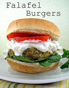 burgers: 2/3 cup red onion, chopped 1/3 cup fresh Italian parsley, chopped 2 tablespoons fresh lemon juice 1 teaspoon ground cumin 1 teaspoon ground coriander 1/2 teaspoon salt 2 (15 1/2-ounce) cans chickpeas, drained and rinsed 3 garlic cloves, minced 2/3 cup seasoned breadcrumbs, divided