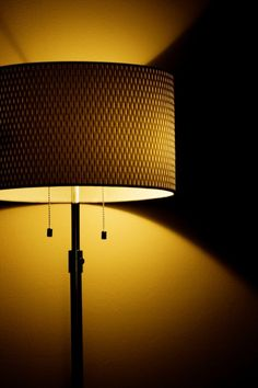 Photograph Warm Orange Glow Illuminated Yellow and Black Indoor Table Lamp Light and Textured Shade Shadow Fine Art Print Home Decor by HenaTayebPhotography Shadow Photos, Shadow Play, Colour Board, Light And Shadow, Fine Art Prints, Wall Lights, Glow, Table Lamp, Illinois State