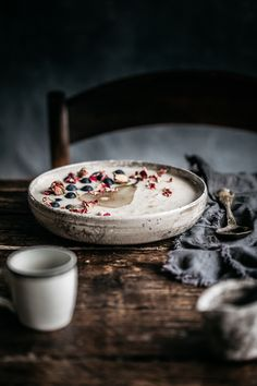 Creamy chilled porridge topped with chia poached pears and a serious lug of maple syrup! Porridge you can enjoy, even in the heat of Summer! Anisa Sabet | The Macadames | Food Styling | Food Photography | Props | Moody | Food Blogger | Recipes