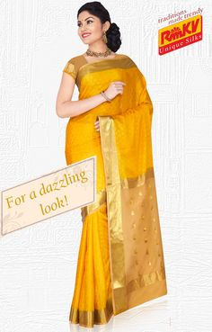 Be ready for any occasion with this gold silk saree with a wide one-side border that has paisley motifs. Click to order - https://www.rmkv.com/product/wedding-collections684-4555