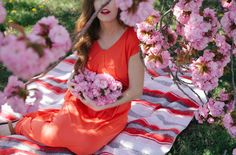 we're having a … baby girl maternity photos in the flowers <3  love this!