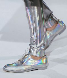 + Hologram pants & silver sneakers made in reflective fabrics and a hologram material by Hussein Chalayan