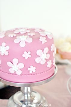 Cute, pop-art style pink flower cake with embossed detail at the base...