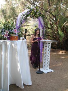Titania, Queen of the Fae at the Wedding Altar.  White Satin tablecloth, Stargazers & Iris, Ring Box.