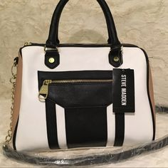 Steve Madden Satchel Steven Madden Satchel. Brand new with tags! Multicolored: black, white, and tan with gold hardware. Beautiful bag!!! Ships fast, same or next day. No trades. Steve Madden Bags Satchels