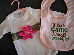 """Pink Camo Baby Girl """"If I'm in Camo Daddy Dressed Me"""" Pink Bib and Matching Onesie - Baby Girl Pink Hunting Bib and Camo Onesie. $16.50, via Etsy."""