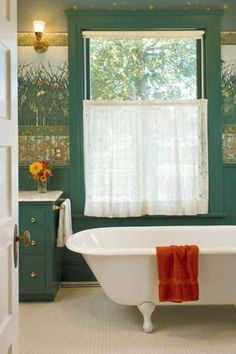 It's probably the multi-part wall treatment (used above a wood wainscot) that makes this bathroom so suited to the 1901 transitional house.