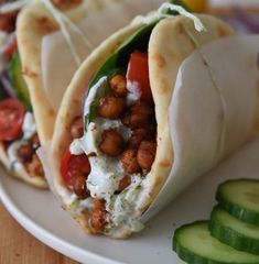 This Roasted Chickpea Gyros recipe is an easy and delicious Mediterranean inspired wrap with refreshing tzatziki sauce. The perfect vegetarian dinner or lunch! // Live Eat Learn recipes Vegetarian Roasted Chickpea Gyros (under 30 minutes! Vegetarian Sandwich Recipes, Veggie Recipes, Lunch Recipes, Whole Food Recipes, Cooking Recipes, Vegetarian Gyro Recipe, Vegetarian Roast Dinner, Easy Vegetarian Dinner Recipes, Garbanzo Bean Recipes