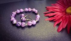 Check out this item in my Etsy shop https://www.etsy.com/listing/544191163/purple-and-black-splatter-beaded