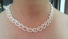 Für einen eleganten aussehen , versuchen Sie diese schöne , handgemachte Halskette .