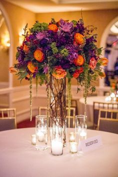 Purple and orange fall arrangement