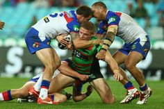 George Burgess of the Rabbitohs is tackled during the round 12 NRL match between the South Sydney Rabbitohs and the Newcastle Knights at ANZ Stadium on June 1, 2013 in Sydney, Australia.