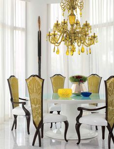 Interesting chairs & Yellow chandelier  Beautiful.