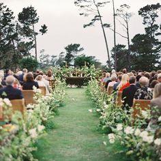"""Ceremony aisle filled with wild blooms lining the path to the aisle."" ~ @sarah_winward  Photo @erichmcvey; planning @coastsidecouture  #SarahWinward #MayeshTakeover"