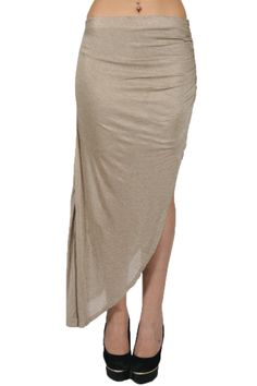 Life is too short to wear boring clothes! Don't settle for mainstream, go a little crazy sometime. Wear this asymmetrical maxi skirt in beautiful beige coloring. The skirt is made of stretchy material, you can wear it low on the hips or high in the waist. Your choice.  #skirts #newfashion #modeskirts  www.2dayslook.com
