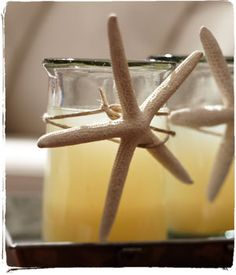 Easy #DIY crafts project: dress up simple glass votives with a bit of twine and starfish. #GHCBeachDays