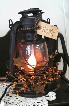 Converted primitive electric lantern by Bushel Basket Candle Co.