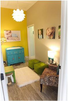 I keep coming back to this picture (a family room in the studio for Luminosity Photography). The bright colors, kid-cozy furniture, fun light fixture and great photos...