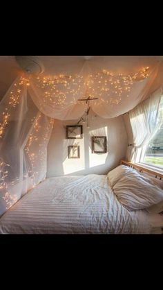 Love this bed and angel lights canopy idea