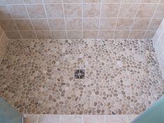 tile shower with pebble floor | marble tiled floor essex junction bathroom remodel custom tiled ...
