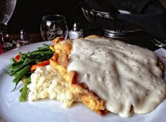 Chicken fried steak is a Texas staple. We do greasy, hearty, and scrumptious all-in-one with this home-style favorite. This is the way mama made it!