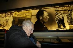 Our brother, Leopold at the Holocaust Museum next to his image from when he was in the concentration camps.