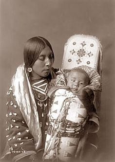 This picture was taken in 1908. It is another portrait by Edward Curtis. The photograph shows an Apsaroke mother and child.