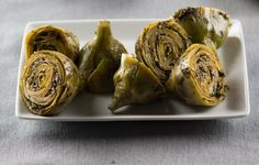 Highlight the fresh flavors of artichokes and transport your kitchen to Rome with Eataly Magazine\& recipe for carciofi alla romana. Meat Delivery, Artichoke Recipes, Fresh Meat, Vegetable Dishes, Vegetable Recipes, Healthy Appetizers, World Recipes, Meatless Monday, The Fresh