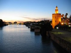 river guadalquivir - seville - sit on the banks with a bottle of wine and watch the world go by
