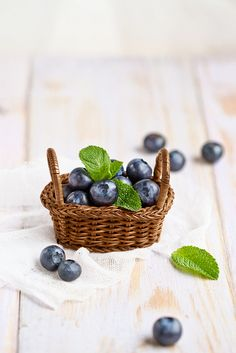 Blueberries. Love that they used a tiny basket. Love the out of focus background blur / bokeh !