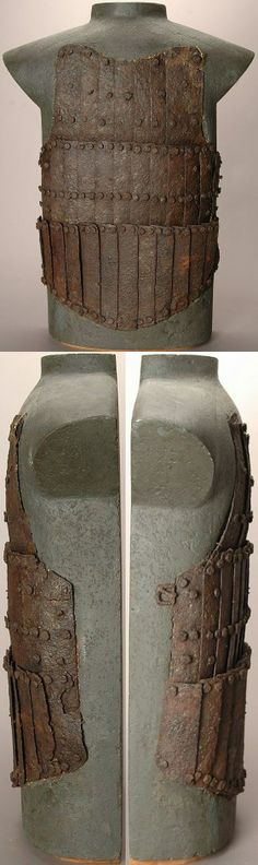 European coat of plates from a mass grave, battle of Visby, fought in July 1361 on the Swedish Baltic island of Gotland, between invading Danish troops and the local, Gutnish, forces. The Danish won a decisive victory. Due to the heat, the dead had to be disposed of quickly, and many were buried in their armour. The archaeological excavation of one of the mass graves, in the 1930s, revealed over 1000 skeletons. Visby #19.