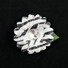 Zebra Mini Bling Daisy Flower:Sometimes you just want a little something to dress up your hair and this flower is perfect! This is a zebra daisy hair flower with a rhinestone center mounted to a flat single prong hair clip. Hand made in the USA. It measures at the longest 2.5 inches $4.00