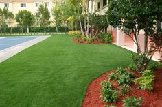EasyTurf turf installation around sport court at an apartment complex www.easyturf.com artificial grass l outdoor living l backyard design l curb appeal l fake grass