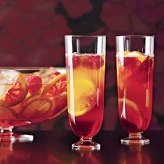 """Italian Spritz Punch Recipe - Agostino Perrone, head mixologist at London's luxurious Connaught Bar, created this simple sparkling punch. """"It would be a great aperitif for a large dinner party,"""" says Wayne Collins; he recommends serving it in teacups. Christmas Cocktails, Holiday Drinks, Party Drinks, Cocktail Drinks, Fun Drinks, Yummy Drinks, Cocktail Recipes, Wine Recipes, Alcoholic Drinks"""