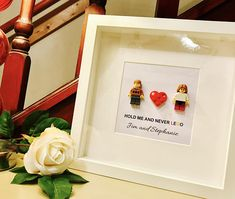 Lego® Valentines Gift Frame - completely customised to look like you and your other half!  HOLD ME AND NEVER Lego®   Any names and any message can be included.  Choose your own hair styles from photos 4 and 5 and faces from photo 6. Clothes will vary according to stock. Extra large frame